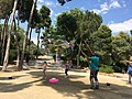 Kids playing with big colored soap bubbles in Park Güell, Barcelona.jpg