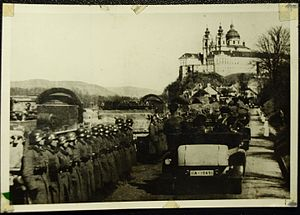 Anschluss - Hitler's motorcade travels along the Danube River in Austria in 1938. Visible in the background is Melk Abby (Kloster Melk).