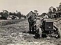 Knut Hamsun (1859-1952) ved siden av en uidentifisert mann på traktor, juni 1929.jpg