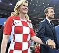 Kolinda Grabar-Kitarović and Emmanuel Macron prepare to award the first and second places in the final of the 2018 Russian Football Cup (cropped).jpg