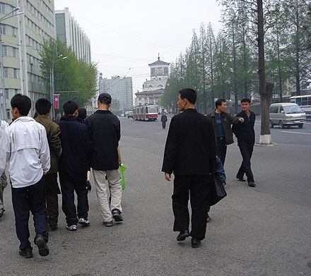 Sneaker-wearing North Korean youths walking in Pyongyang Korean youth on Pyongyang street.jpg