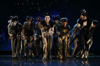 """Mr. Mistoffelees - Dariusz Wiórkiewicz as Sierściuch, Patryk Gładyś as Turbo Ptyś, Robert Adamczewski as Alonzo, Karol Tymiński as Raptus Zuch (Rumpus Cat) and Paweł Irmiński as Mefistofeliks (Mr Mistoffelees) in the musical """"Cats"""" in Roma Musical Theatre in Warsaw in December 2007."""