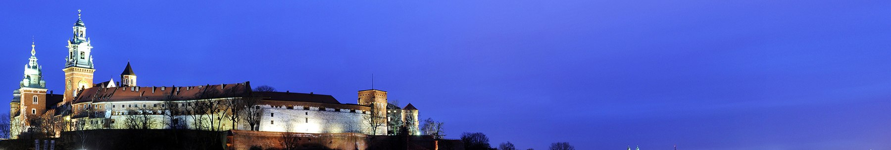 Krakow banner Wawel hill by twilight.jpg
