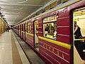 Krasnaya strela (Red arrow) train at Krasnoselskaya station (Метропоезд Красная стрела на станции Красносельская) (5234701298).jpg