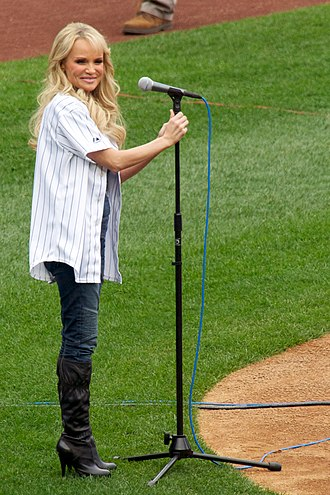 Performance - Kristin Chenoweth performs the national anthem of the United States at a baseball game
