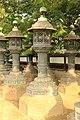 LAMPS OR BELL HOLDERS BY SHRINE IN TOKYO.jpg