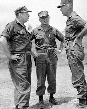 Henry W. Buse Jr. - Lieutenant General Henry W. Buse, Jr., Brigadier General Michael P. Ryan, and Major General Bruno A. Hochmuth (both 3rd Marine Division), discuss matters of the coming events for Camp Carroll, Vietnam.