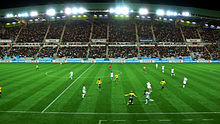 Wide-angle photo of a football match