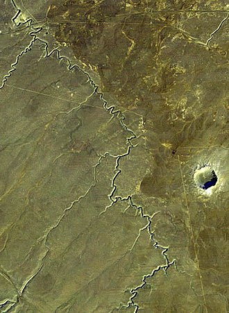 Meteor Crater - The Barringer Meteor Crater from space. The Diablo Canyon arroyo is to the west (left). The ghost town of Diablo Canyon, for which the meteorite is named, is on the canyon just to the north and out of the picture.