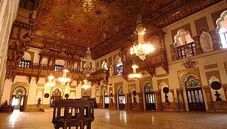 Laxmi Vilas Palace, Vadodara - Darbar hall featuring ornate artwork.