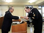 Legalman 1st Class Donald McDowell recognized by Misawa, Japan Tourism Association 160122-N-EC644-009.jpg