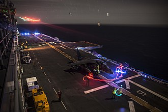 USS Essex (LHD-2) - An AV-8B Harrier prepares to take-off aboard Essex, off the coast of San Diego, 24 February 2015