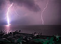 Lightning flashes as the aircraft carrier USS Abraham Lincoln (CVN 72) transits the Strait of Malacca.jpg
