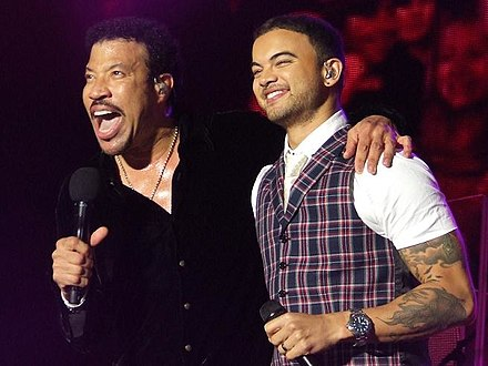 "Richie and Guy Sebastian performing ""All Night Long"" during Richie's 2011 Australian and New Zealand tour Lionel Richie and Guy Sebastian.jpg"