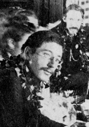 Lloyd Osbourne - Photograph of Lloyd Osbourne (with Robert Louis Stevenson) attending a Royal Luau thrown by King Kalākaua, Honolulu, Hawaii, c. 1889