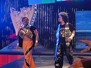 The Colóns (2002–2010) - Primo (left) and Carlito (right) as Unified Tag Team Champions.