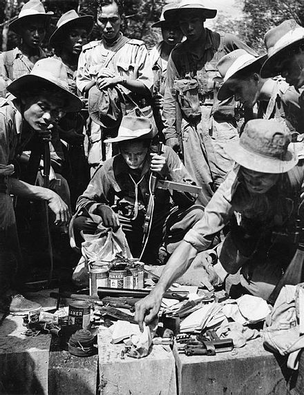 Members of the Royal Malay Regiment during the Malayan Emergency in 1949, inspecting equipment captured in a raid. Malay Regiment operatives 1949.JPG