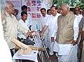 Mallikarjun Kharge visiting the stalls, at the Public Information Campaign on Bharat Nirman, at Gulbarga, Karnataka on September 10, 2013. The Karnataka State Minorities Welfare Minister, Shri Qamar Ul Islam is also seen.jpg