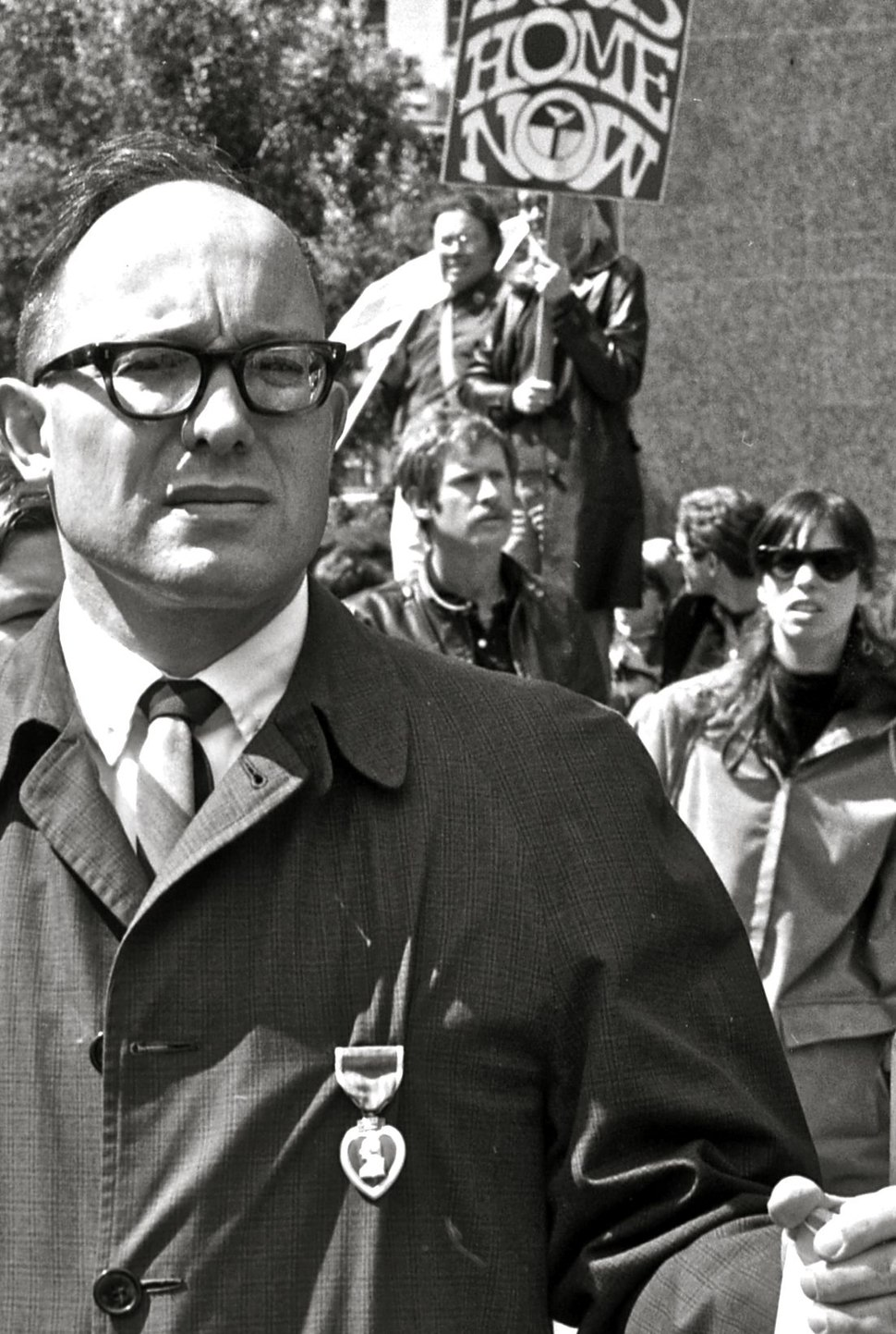 Man wearing Purple Heart medal during Vietnam peace march, 1967