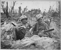 Marine Private First Class Douglas Lightheart (right) cradles a 30-caliber machine gun in his lap, while he and his... - NARA - 532538.tif