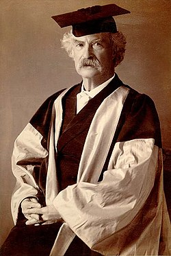Mark Twain in his gown (scarlet with grey sleeves and facings) for his DLitt degree, awarded to him by Oxford University.