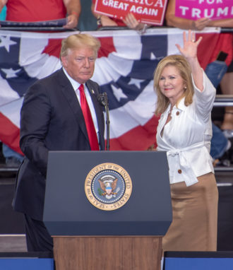 Blackburn and President Donald Trump waving at Nashville Rally in 2018 Marsha Blackburn and Donald Trump waving at Nashville Rally 2.png