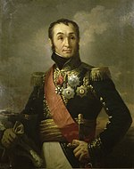 Painting shows a clean-shaven man with a cleft chin, receding hairline and high-arching eyebrows. He wears a dark blue military uniform with much gold braid, many medals and a red sash.