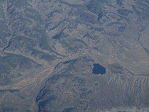 Cochetopa Hills - Aerial view of McDonough Reservoir No. 2 in the Cochetopa Hills.