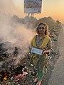 Measuring PM2.5 air pollution from a burning roadside garbage dump at Bhiwandi near Mumbai.jpg