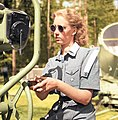 Member of Lotta Svärd (Finnish voluntary auxiliary paramilitary organisation for women) being trained for the use of searchlights in anti-aircraft duties, Helsinki, Laajasalo (Degerö), 15 July 1944. (50274671172).jpg