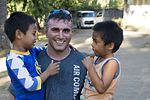 Members of the 353rd Special Operations Group help children in the Phillipines 170221-N-IM663-141.jpg