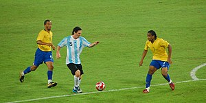 Lionel Messi competing in the 2008 Summer Olympic Games in a match against Brazil