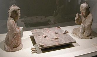 Liubo - A pair of Eastern Han Dynasty (25–220 CE) ceramic tomb figurines of two gentlemen playing liubo