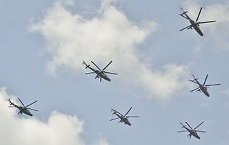 Azerbaijani Air and Air Defence Force - Air Force Mil Mi-24's fly over during an army parade