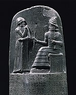 Shamash (the Babylonian sun god) hands King Hammurabi a code of law