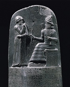 Law - King Hammurabi is revealed the code of laws by the Mesopotamian sun god Shamash, also revered as the god of justice.