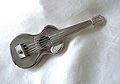 Miniature silver guitar.jpg