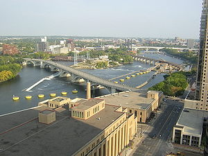 Saint Anthony Falls - Mississippi River at Minneapolis today, looking downstream. The bridge in the foreground is the Third Avenue Bridge, behind it are the Upper St Anthony Falls to the left and the upper lock and dam to the right, followed by the Stone Arch Bridge. The new I-35W Saint Anthony Falls Bridge can be seen in the background.