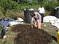 Mixing the compost heap manually (6881928413).jpg