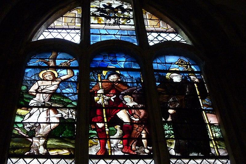 Glassmaleri nr. 23 i den katolske sognekirken Saint-Pierre i Montfort-l'Amaury fra midten/slutten av 1500-tallet som viser de hellige Sebastian, Rochus og Godo
