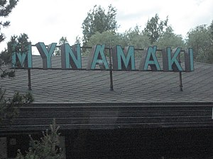 Finnish orthography - The sign at the bus station of the Finnish town Mynämäki, illustrating a variation of the letter Ä.
