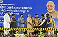 Narendra Modi being presented a memento by the Chief Minister of Maharashtra, Shri Devendra Fadnavis, at public meeting, in Mumbai. The Governor of Maharashtra, Shri C. Vidyasagar Rao.jpg