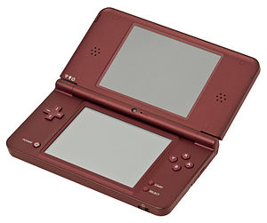 Nintendo DS family - A burgundy Nintendo DSi XL in its opened position.