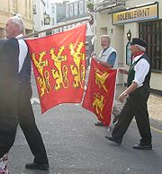 Two-leopard and three-leopard flags at a Norman language festival in Jersey