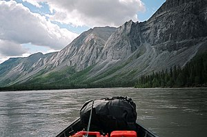 North Nahanni River flows past the Battlement Range.jpg