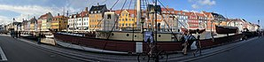 Nyhavn - Panorama looking across Nyhavn, from south side to north, with the lightship in foreground, and other museum ships