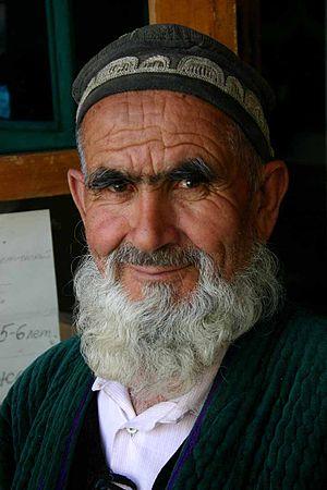 Demographics of Tajikistan - A Tajik man in traditional headgear (2005).