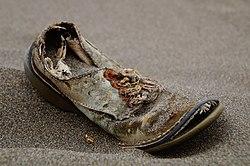 Old brown shoe with bad sole. (Unsplash).jpg