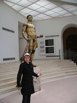 Olivia Tennet in front of a statue of hercules.jpg