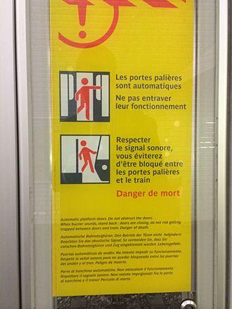 Platform screen doors - Warning sign in France